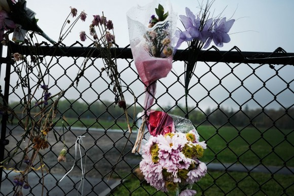 Flowers are placed along a fence near where the bodies of four brutally beaten young men  were recently discovered on April 28, 2017 in Central Islip, New York. (Spencer Platt/Getty Images)