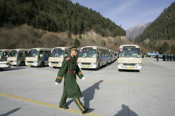 "JIUZHAIGOU, CHINA:  A Chinese paramilitary soldier inspects parking area at Jiuzhaigou Nine-village valley) in the Aba Tibetan and Qiang Autonomous Prefecture in China's southwestern province of Sichuan, 09 January 2006. The famous attraction tourism Jiuzhaigou Valley is known as the ""fairyland on the Earth"", was listed by the World Heritage Council of UNESCO into the Catalogue of World Natural Heritage in 1992.  AFP PHOTO/ LIU Jin  (Photo credit should read LIU JIN/AFP/Getty Images)"