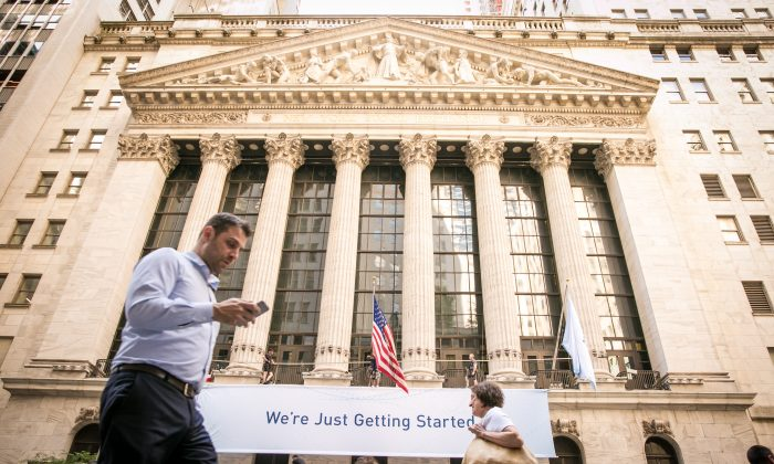 People walk by the New York Stock Exchange in the Financial District of Manhattan on June 26, 2017. (Benjamin Chasteen/The Epoch Times)