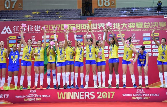 The Brazilian team celebrates winning a record 12th FIVB Women's Volleyball Grand Prix, in Nanjing on August 6, 2017. (Eddy/Getty Images)