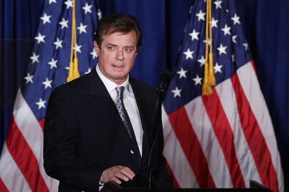 """Paul Manafort, advisor to Republican presidential candidate Donald Trump's campaign, checks the teleprompters before Trump's speech at the Mayflower Hotel April 27, 2016 in Washington, DC. A real estate billionaire and reality television star, Trump beat his GOP challengers by double digits in Tuesday's presidential primaries in Pennsylvania, Maryland, Deleware, Rhode Island and Connecticut. """"I consider myself the presumptive nominee, absolutely,"""" Trump told supporters at the Trump Tower following yesterday's wins.  (Chip Somodevilla/Getty Images)"""