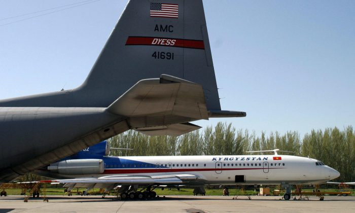 Undated file picture shows Kyrgyz passenger jet Tu-154 (background) and US military aircraft at an airfield of Manas airport outside Bishkek.  (VYACHESLAV OSELEDKO/AFP/Getty Images)