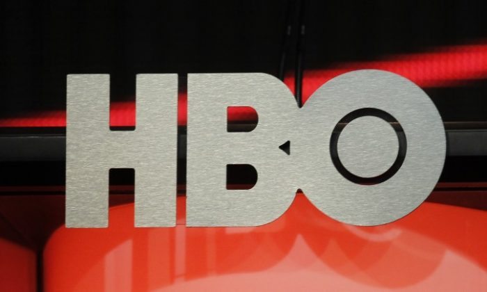 The logo for HBO,Home Box Office, the American premium cable television network, owned by Time Warner, is pictured during the HBO presentation at the Cable portion of the Television Critics Association Summer press tour in Beverly Hills, California August 1, 2012. (REUTERS/Fred Prouser)
