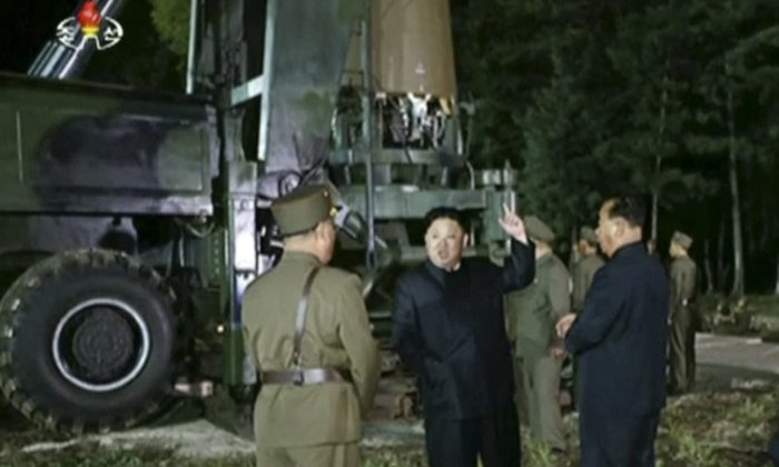 In this file image made from video by North Korea's KRT released on July 28, 2017, North Korean leader Kim Jung Un, second from right, gestures at the site of a missile test at an undisclosed location in North Korea. (KRT via AP Video, File)