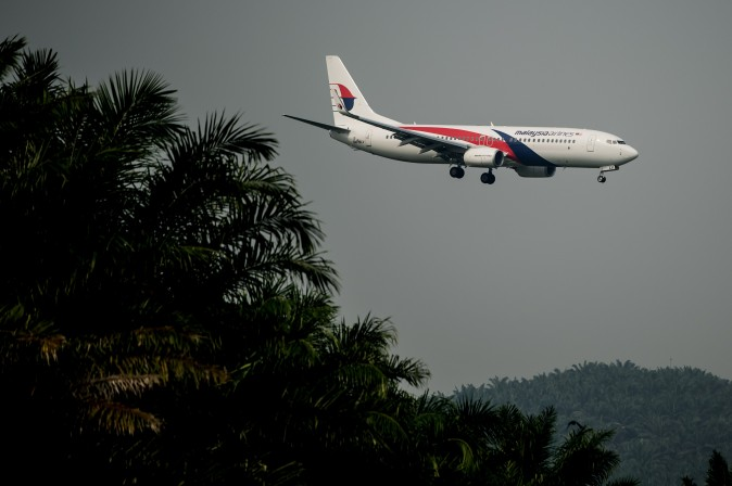 A Malaysia Airlines plane prepares for landing at the Kuala Lumpur International Airport in Sepang, outside Kuala Lumpur on July 21, 2014. (MOHD RASFAN/AFP/Getty Images)