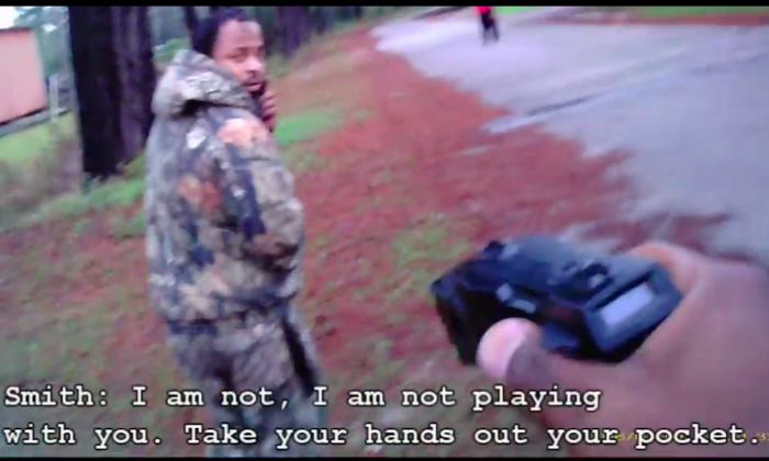 South Carolina Police officers Quincy Smith points a taser at suspect Malcolm Antwan Orr. (Screenshot via 14th Circuit Solicitor's Office)