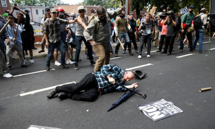A man is down during a clash between members of white nationalist protesters and a group of counter-protesters in Charlottesville, Virginia, U.S., August 12, 2017.   REUTERS/Joshua Roberts