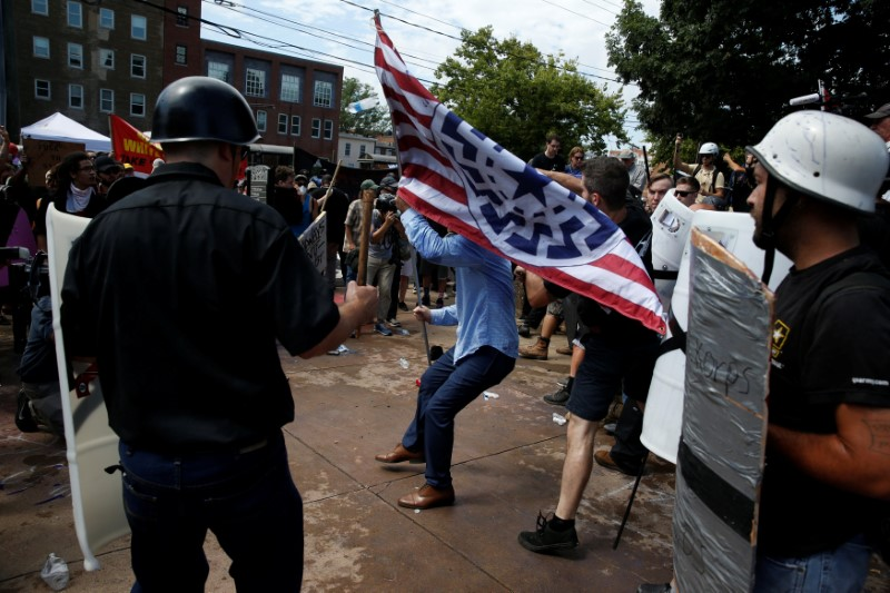 Members of white nationalist protesters are confronted by a group of counter-protesters in Charlottesville, Virginia, U.S., August 12, 2017.   REUTERS/Joshua Roberts