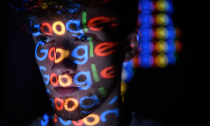 Google logo projected onto a man on August 09, 2017 in London, England. (Leon Neal/Getty Images)