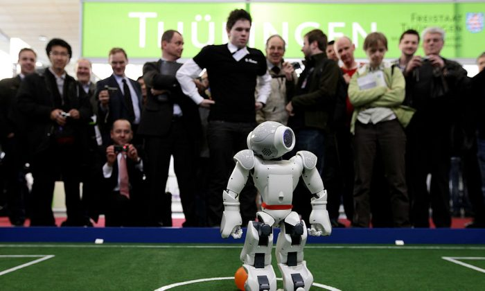 Robots play football in a demonstration of artificial intelligence at the stand of the German Research Center for Artificial Intelligence.  (Photo by Sean Gallup/Getty Images)