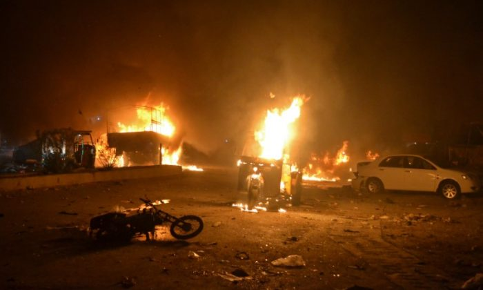 Vehicles are seen burning after a bomb blast in Quetta, Pakistan August 12, 2017. (Reuters/Naseer Ahmed)