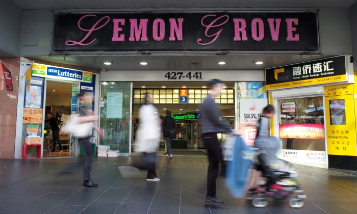 Shoppers walk past the entrance to the Lemon Grove shopping mall in Sydney, Australia, August 11, 2017, site of a shopfront company at the heart of one of Australia's biggest money laundering scandals. (Reuters/Jason Reed)