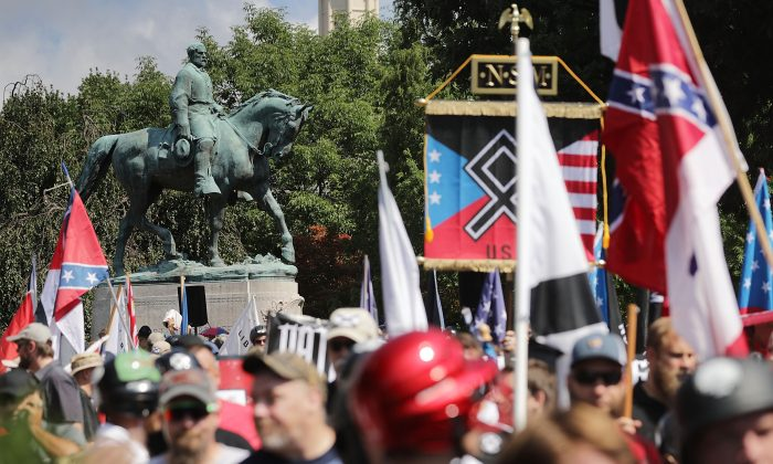 "The statue of Confederate General Robert E. Lee stands behind a crowd of hundreds of white nationalists, neo-Nazis and members of the ""alt-right"" during the ""Unite the Right"" rally August 12, 2017 in Charlottesville, Virginia.  (Chip Somodevilla/Getty Images)"