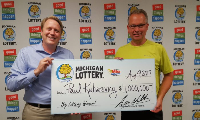 Paul Kuharevicz wound up purchasing a $1 million winning lottery ticket after his flight home from a business trip was canceled.Photo courtesy of Michigan Lottery