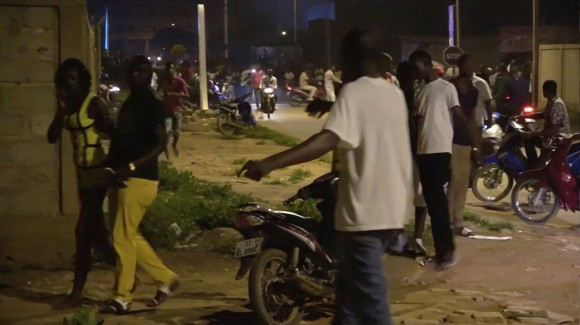 Restaurant customers run in the street following an attack by gunmen on a restaurant in Ouagadougou, Burkina Faso, in this still frame taken from video August 13, 2017. REUTERS/Reuters TV