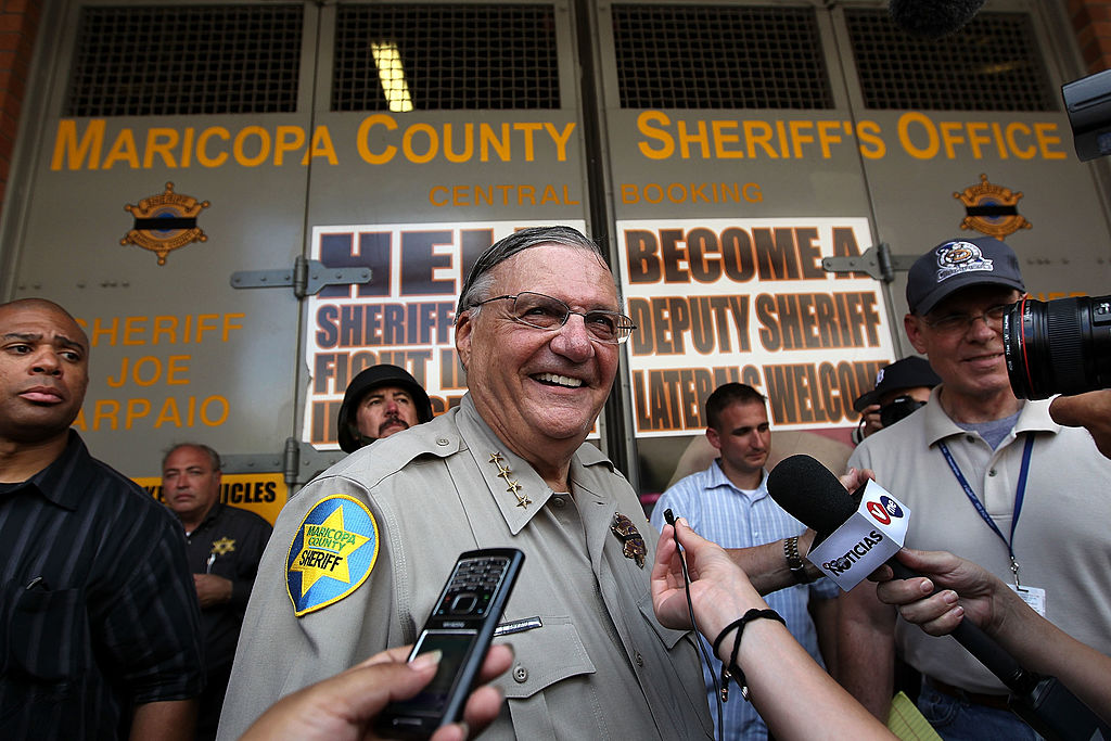 Maricopa County Sheriff Joe Arpaio stands in front of his county jail the day Arizona's immigration enforcement law SB 1070 went into effect on July 29, 2010 in Phoenix, Arizona. (John Moore/Getty Images)