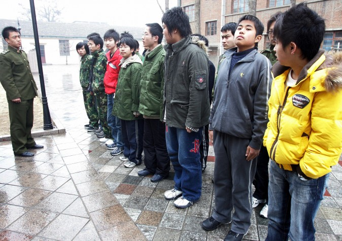Some 20-odd teenagers assemble at the Internet Addiction Treatment Centre in the southeastern suburb of Daxing in Beijing, 01 March 2007, all placed there involuntarily by their family, to go through a strict regimen that might as well be boot camp. (AFP/AFP/Getty Images)