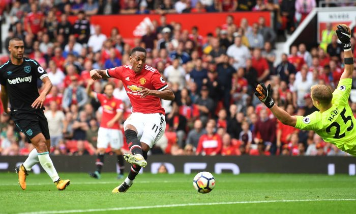 Anthony Martial of Manchester United scores his sides third goal past Joe Hart of West Ham United during their Premier League match at Old Trafford on August 13, 2017. (Michael Regan/Getty Images)