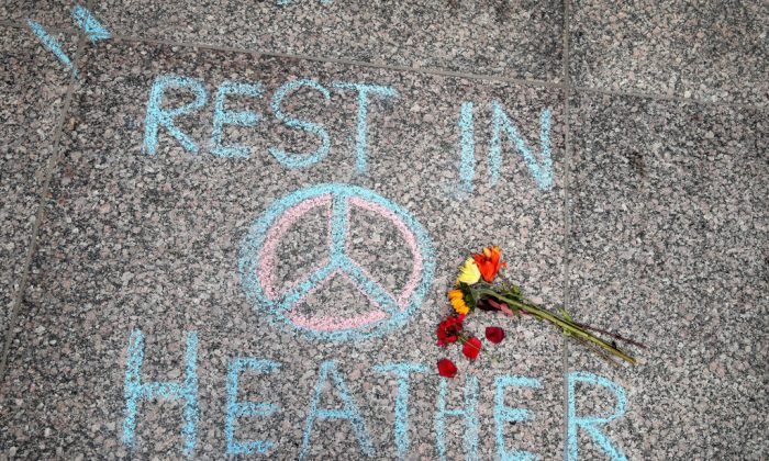 Flowers are laid on a memorial to Heather Heyer that was chalked on the pavement during a demonstration on August 13, 2017 in Chicago, Illinois. (Scott Olson/Getty Images)