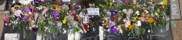 An informal memorial is seen at the place where 32-year-old Heather Heyer was killed when a car plowed into a crowd of people protesting against the Unite the Right rally August 14, 2017 in Charlottesville, Virginia.  (Chip Somodevilla/Getty Images)