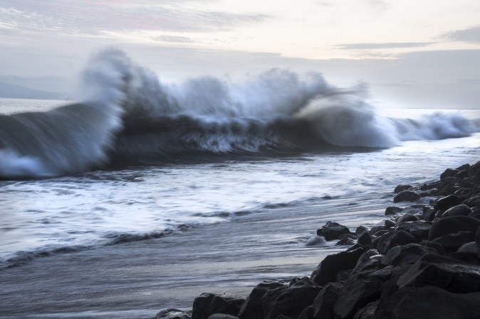 Heavy waves caused by offshore storms crash on a beach in Puntarenas, Costa Rica, on Aug. 13, 2017. (EZEQUIEL BECERRA/AFP/Getty Images)