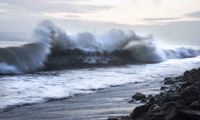 Heavy waves caused by offshore storms crash on a beach. (Ezequiel Becerra/AFP/Getty Images)