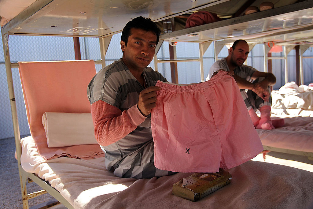 "Undocumented immigrant Sam Ramos, 39, shows off his jail-issued pink underwear in the Maricopa County ""Tent City Jail"" on April 30, 2010 in Phoenix, Arizona. (John Moore/Getty Images)"