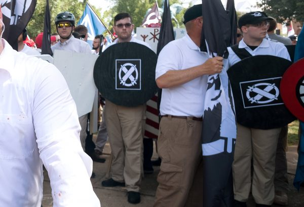 "James Alex Fields Jr., (2nd L with shield) is seen attending the ""Unite the Right"" rally"