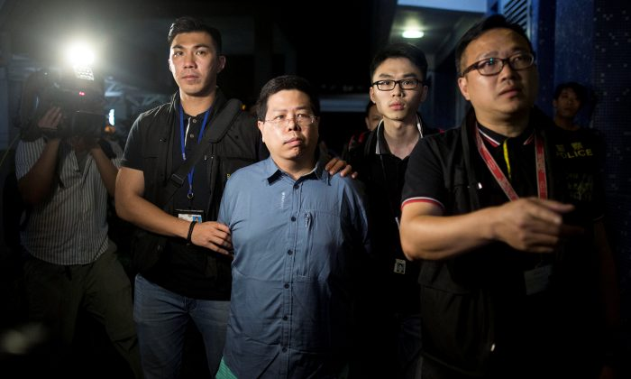 "Police arrests Democratic Party member Howard Lam (C) for ""misleading police"" after he claimed he had been assaulted and illegally detained by mainland Chinese agents, in Hong Kong, China, China August 15, 2017. (The Initium/Lam Chun Tung via Reuters)"