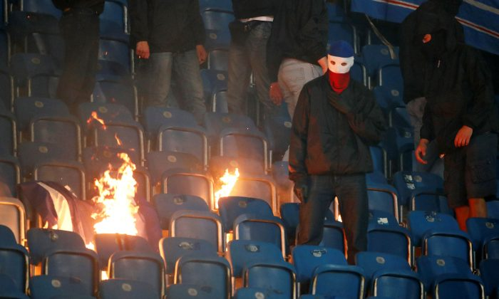 Fans around a fire at Hansa Rostock v Hertha Berlin, DFB Cup First Round in Rostock, Germany, August 14, 2017.  (Reuters/Hannibal Hanschke)