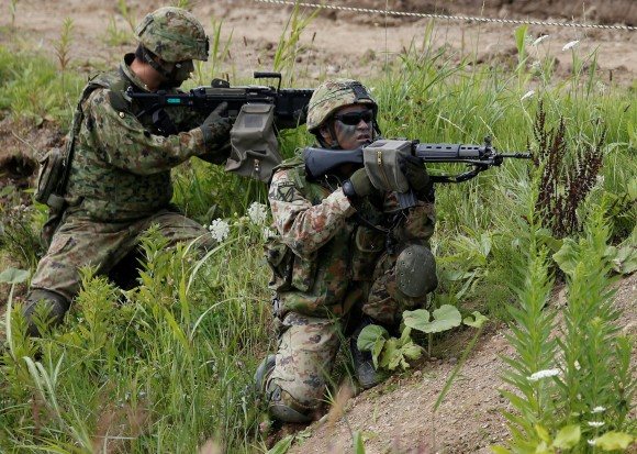 Japan Ground Self Defense Force members take part in their joint exercise, named Northern Viper 17, with U.S. Marine Corps at Hokudaien exercise area in Eniwa, on the northern island of Hokkaido, Japan, August 16, 2017.   (Reuters/Toru Hanai)