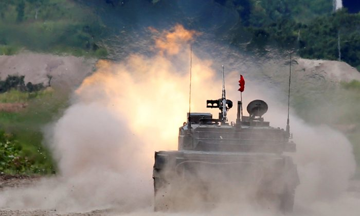 A Japan Ground Self Defense Force's Type 90 tank fires during their joint exercise, named Northern Viper 17, with U.S. Marine Corps at Hokudaien exercise area in Eniwa, on the northern island of Hokkaido, Japan, August 16, 2017.   (Reuters/Toru Hanai)