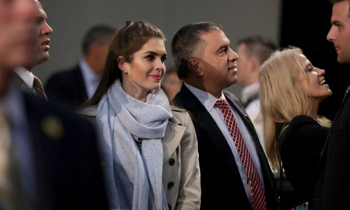 Hope Hicks, Deputy campaign manager David Bossie and campaign manager Kellyanne Conway listen to Trump during their final campaign rally on Election Day in the Devos Place  in Grand Rapids, Michigan on Nov. 8, 2016. (Chip Somodevilla/Getty Images)