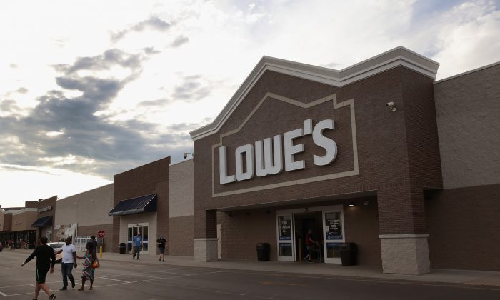 Customers shop at a Lowe's home improvement store on July 25, 2017 in Chicago, Illinois. A shortage of new single-family homes in the U.S. is causing many home owners to renovate their existing homes rather than move, which is driving up earnings and stock prices for home improvement retailers.  (Photo by Scott Olson/Getty Images)