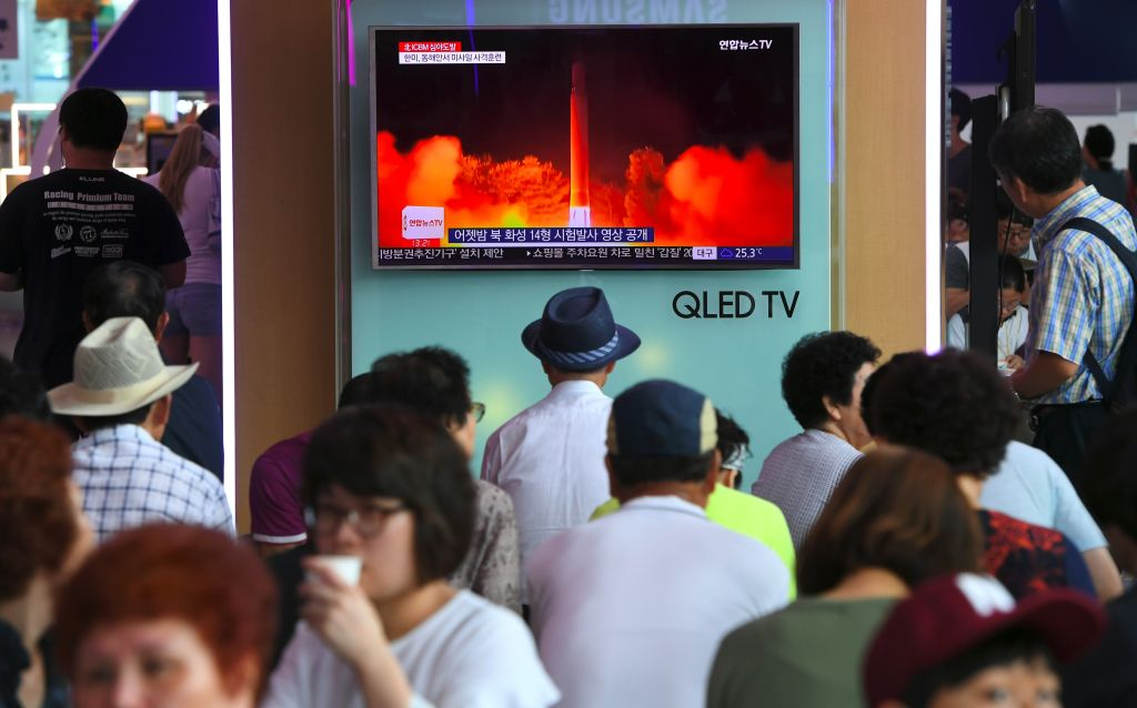 People watch a television screen showing a video footage of North Korea's latest test launch of an intercontinental ballistic missile (ICBM), at a railway station in Seoul on July 29, 2017. (JUNG YEON-JE/AFP/Getty Images)