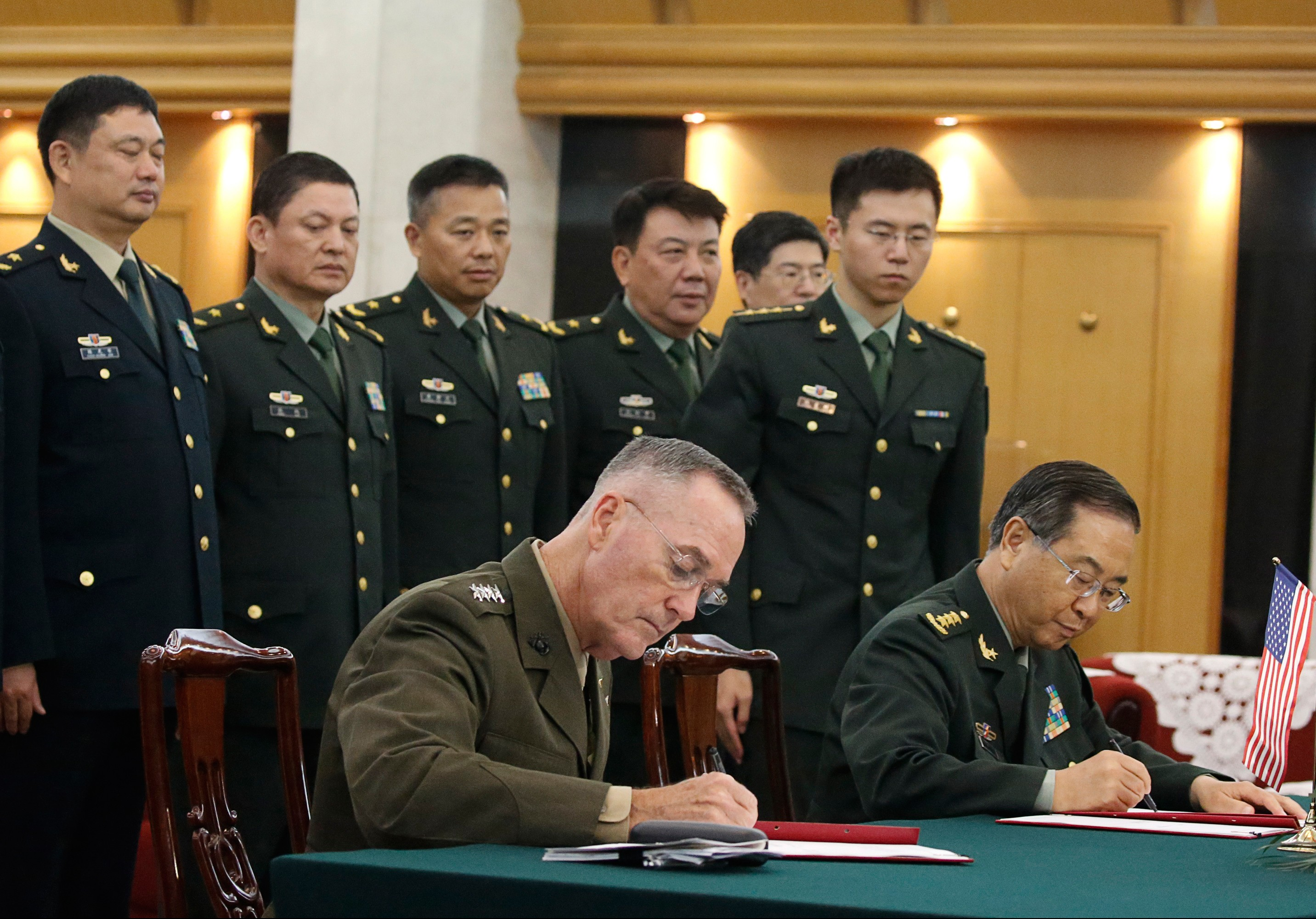 General Joseph Dunford (front L), chairman of the US Joint Chiefs of Staff, and his Chinese counterpart General Fang Fenghui, chief of the general staff of the Chinese People's Liberation Army, attend a signing ceremony in Beijing on Aug. 15, 2017. (THOMAS PETER/AFP/Getty Images)
