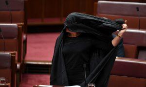 Australia's Hanson Wears Burqa to Parliament in Bid to Ban Them
