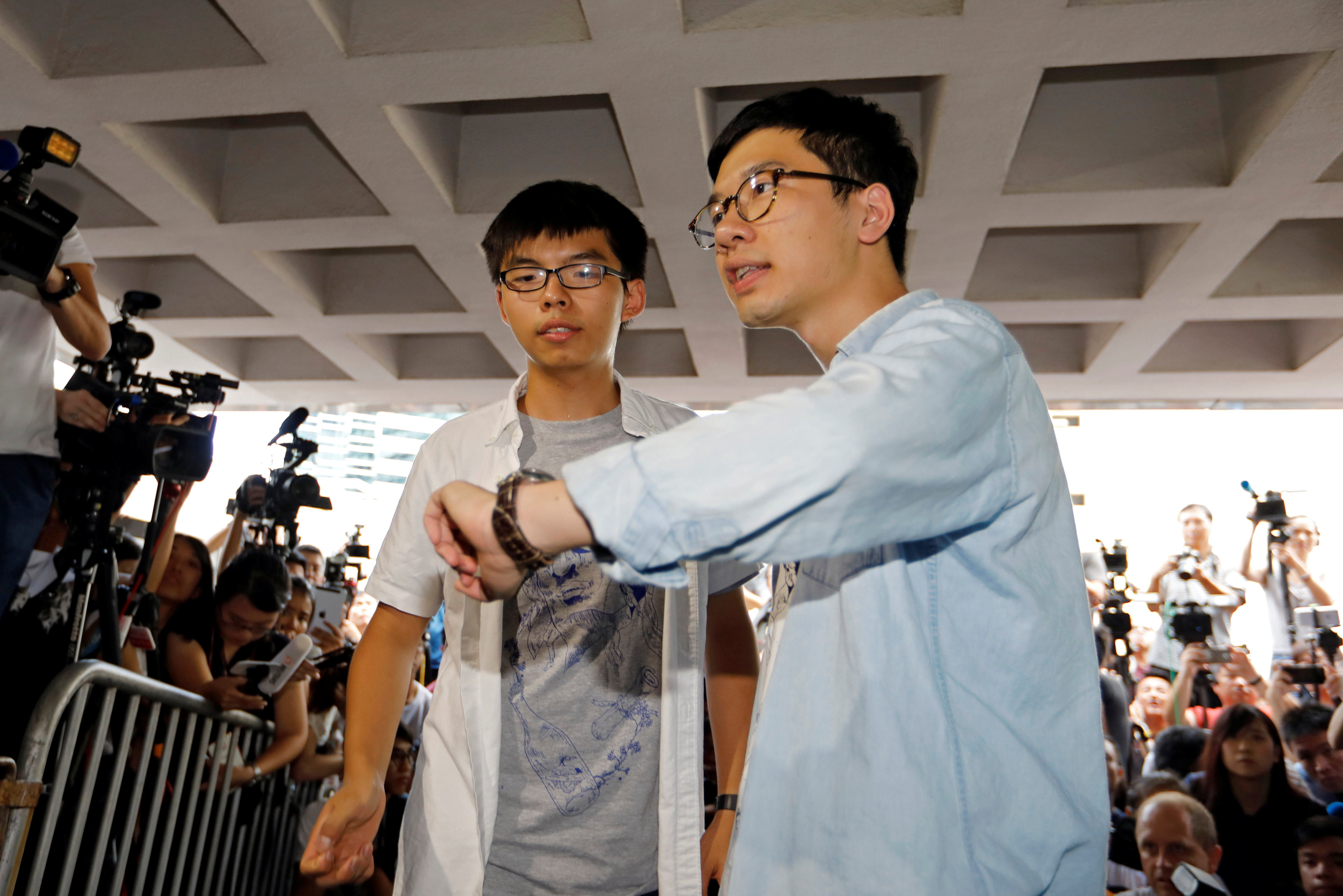 Student leaders Joshua Wong and Nathan Law arrive at the High Court to face verdict on charges relating to the 2014 pro-democracy Umbrella Movement, also known as Occupy Central protests, in Hong Kong, China on August 17, 2017. (REUTERS/Tyrone Siu)