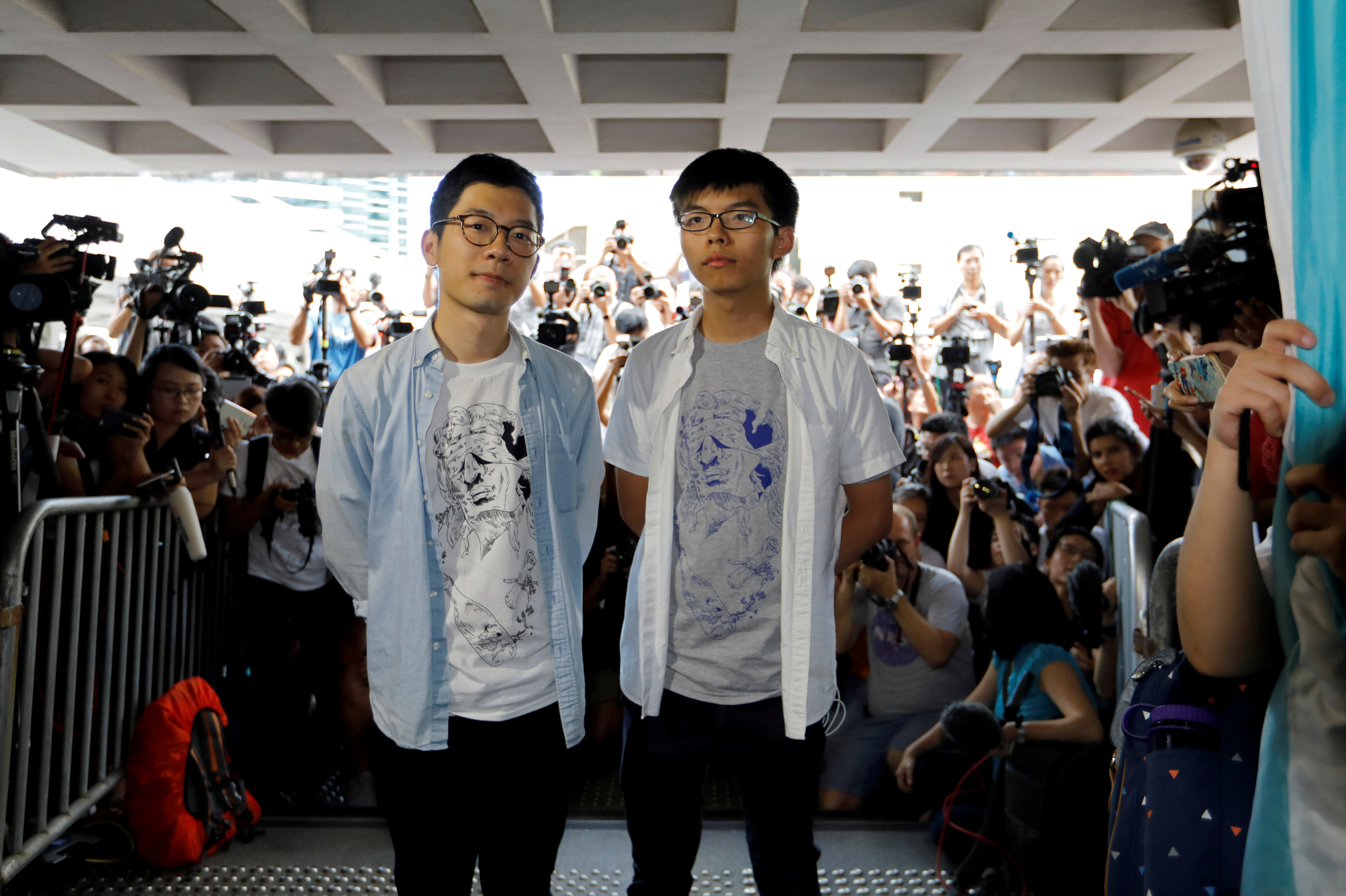 Student leaders Nathan Law and Joshua Wong arrive at the High Court to face verdict on charges relating to the 2014 pro-democracy Umbrella Movement, also known as Occupy Central protests, in Hong Kong, China on August 17, 2017. (REUTERS/Tyrone Siu)