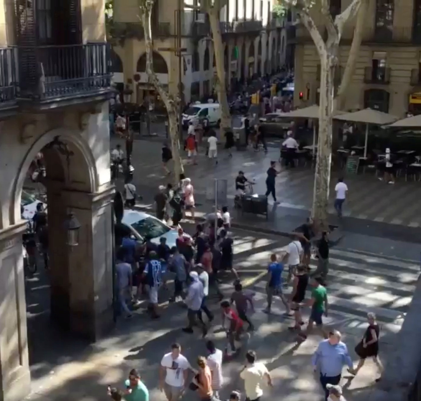People move from the scene after a van crashed into pedestrians near the Las Ramblas avenue in central Barcelona, Spain August 17, 2017, in this still image from a video obtained from social media. Courtesy of McKenzie Tavoda/via REUTERS