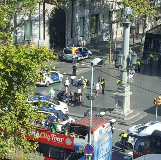Police and emergency services attend to injured persons at the scene after a van crashed into pedestrians near the Las Ramblas avenue in central Barcelona, Spain on Aug.17, 2017, in this still image from a video obtained from social media. (Courtesy of  @Vil_Music/via REUTERS)