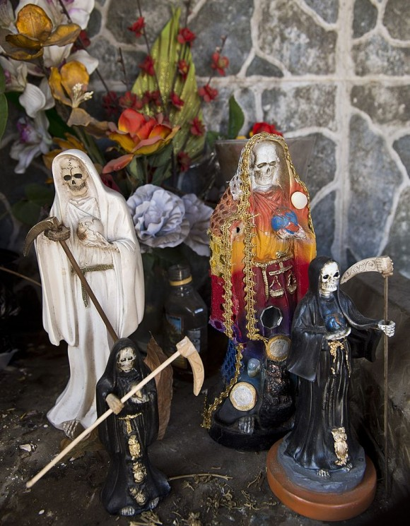 """Images of the """"San La Muerte"""" (saint death) at the entrance of the town of Arteaga, in Michoacan State, Mexico, on May 11, 2014. Arteaga is the village where drug trafficker Servando Gomez aka La Tuta, the leader of the Knights Templar cartel, is from. AFP PHOTO/RONALDO SCHEMIDT/Getty Images"""