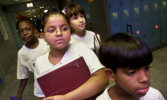 "Students at ""Knowledge is Power Program"" (KIPP) Academy walk in the hallway October 4, 2000 in The Bronx, New York.Chris Hondros/Newsmakers)"