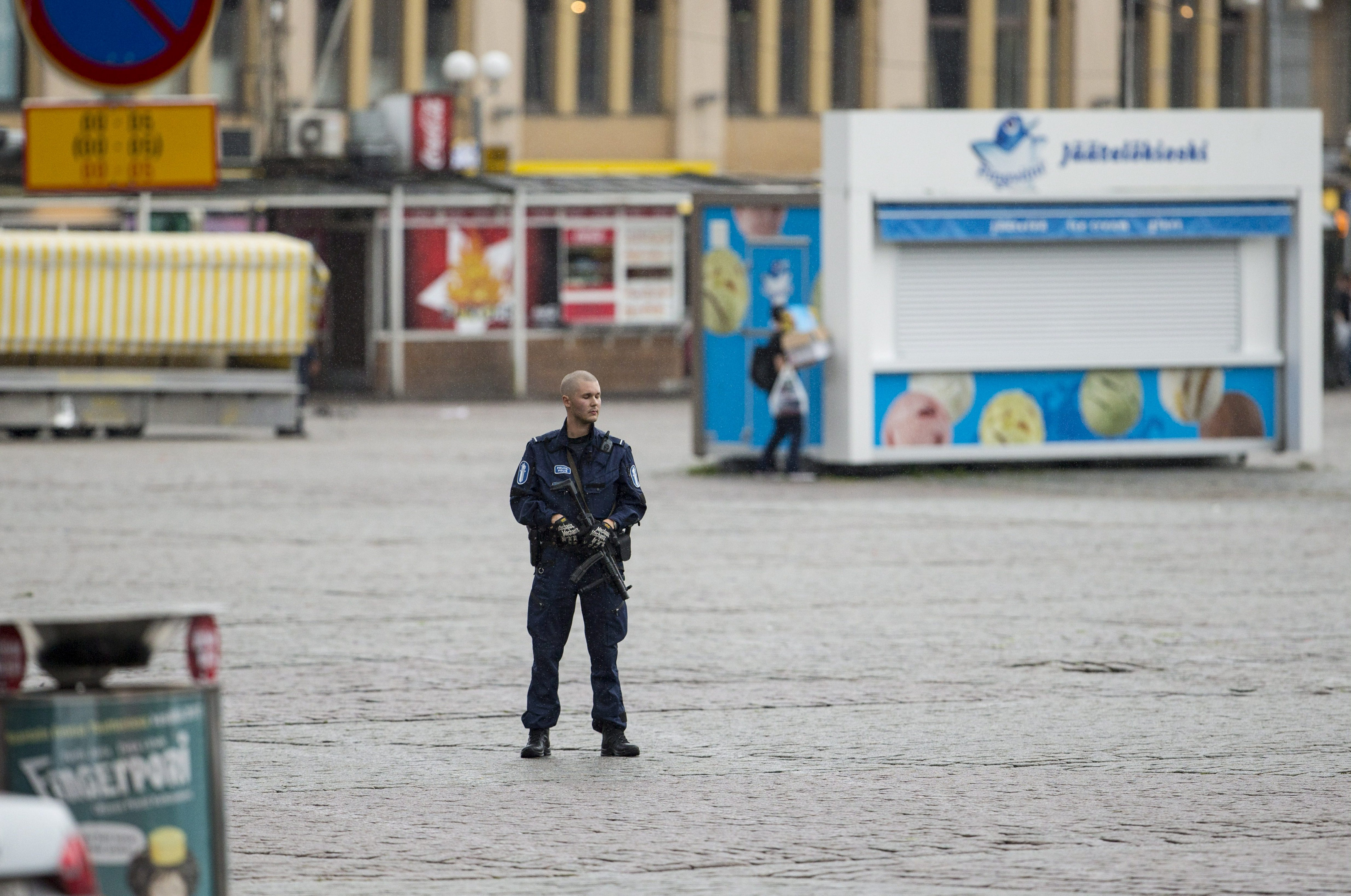 A police keeps watch at the Turku Market Square after several people were stabbed, in Finland August 18, 2017.  LEHTIKUVA/Roni Lehti via REUTERS