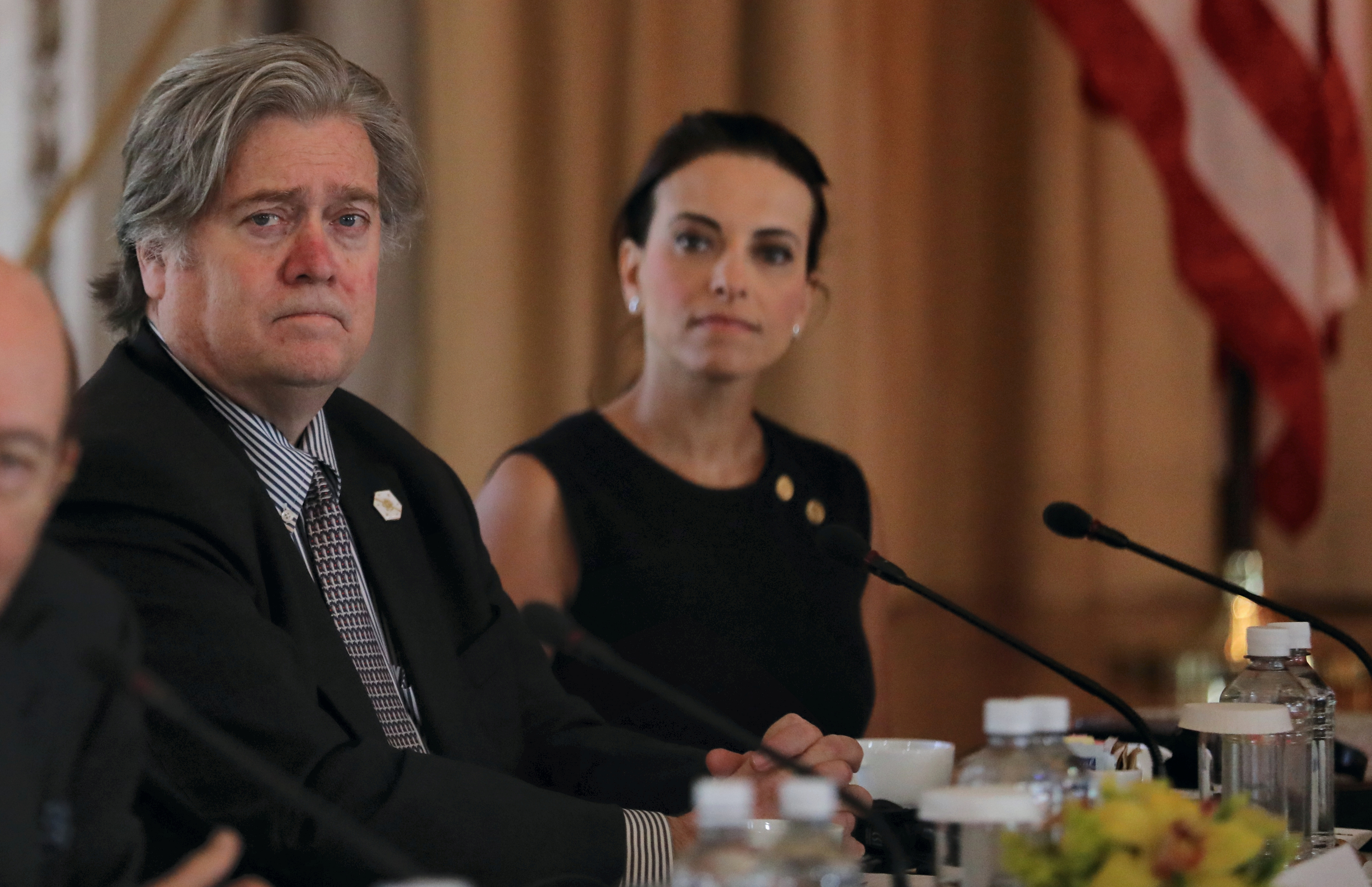 White House Chief Strategist Steve Bannon (L) listens with U.S. Deputy National Security Advisor for Strategy Dina Powell (R) during a bilateral meeting between U.S. President Donald Trump (L) and China's President Xi Jinping (Not Pictured) at Trump's Mar-a-Lago estate in Palm Beach, Florida on April 7, 2017. (REUTERS/Carlos Barria)