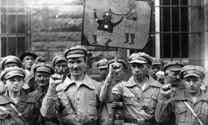 Members of the far-left Antifa extremist organization give a clenched fist salute on Sept. 1, 1928. The group's original intent was to bring out a communist dictatorship in Germany. (Fox Photos/Getty Images)
