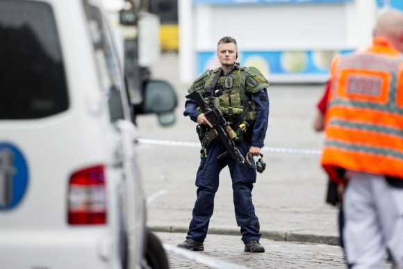 An armed police officer stands guard at the Turku Market Square in the Finnish city of Turku where several people were stabbed on August 18, 2017. One person was killed and eight were injured in a stabbing spree in the Finnish city of Turku, a hospital director said, after police shot one suspect and warned several others could be at large. (RONI LEHTI/AFP/Getty Images)