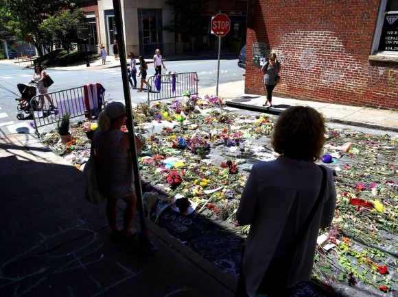 Flowers lay on the street where Heather Heyer was killed and 19 others injured when a car slammed into a crowd of people protesting against a white supremacist rally, August 18, 2017 in Charlottesville, Virginia. (Mark Wilson/Getty Images)