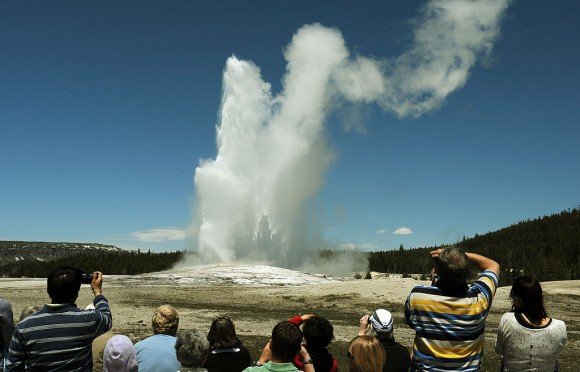 Tourists watch the 'Old Faithful' geyser which erupts on average every 90 minutes in the Yellowstone National Park, Wyoming on June 1, 2011. (MARK RALSTON/AFP/Getty Images)