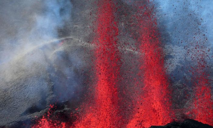 Lava errupts from the Piton de la Fournaise, the volcano of the French Indian Ocean island of Reunion, which erupted early on July 14, 2017. (RICHARD BOUHET/AFP/Getty Images)